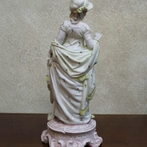 Young Lady in Yellow Dress Figurine