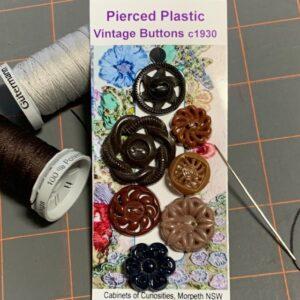 Pierced Plastic Vintage Buttons x 7 (code 081)